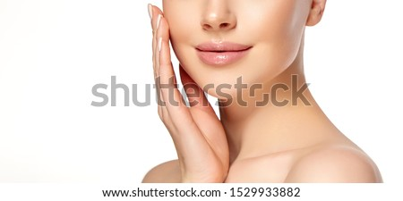 Beautiful young woman with clean fresh skin on face . Girl facial  treatment   . Cosmetology , beauty  and spa . Royalty-Free Stock Photo #1529933882