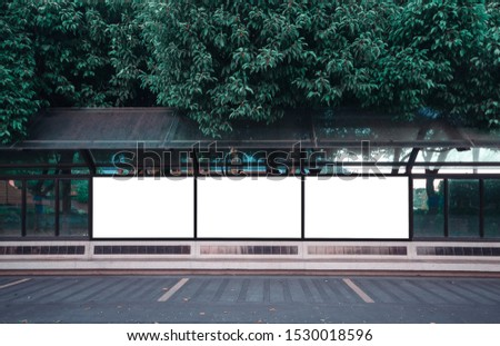 big blank billboard white LED screen horizontal outstanding in the city on pathway walking at side the road traffic with people for display advertisement text template promotion new brand at outdoor.