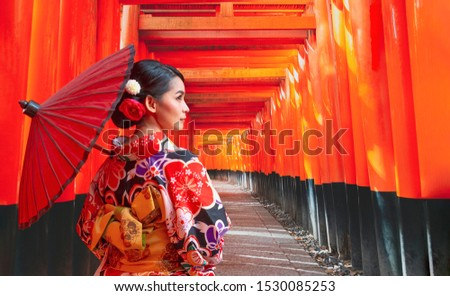 Women in traditional japanese kimonos walking at Fushimi Inari Shrine in Kyoto, Japan, Kimono women and umbrella, Kyoto  Royalty-Free Stock Photo #1530085253