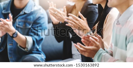 Creative designers audience applauding at a business seminar. Asian People listening and clapping at conference and presentation. Royalty-Free Stock Photo #1530163892
