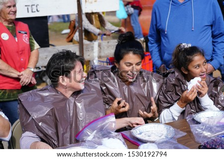 Warrens, Wisconsin / USA - September 28th, 2019: Adults, young adults, teenagers, and kids competed in pie eating contest at Warrens Cranberry Festival 2019  #1530192794