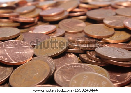 A pile of lose change British copper coins.A close up of 2p and 1p,UK coins. #1530248444