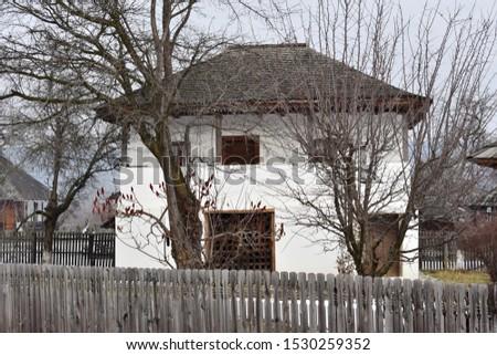 Wooden house in winter landscape in Romania #1530259352