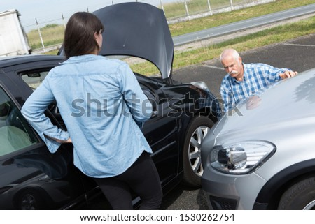 two drivers arguing after traffic accident #1530262754