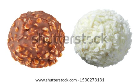 Beautiful pair of white and dark chocolate ball shaped candies with filling, nuts and coconut shavings isolated on white background. Full sharpness across the entire field of the frame. #1530273131