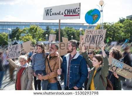 People with placards and posters on global strike for climate change. #1530293798