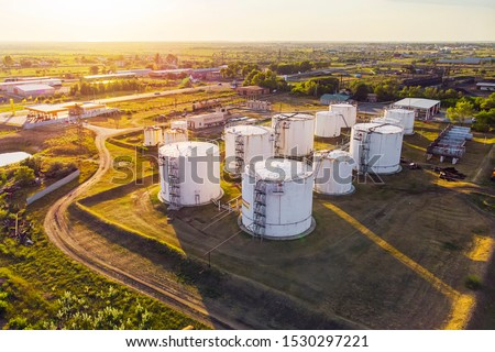 Tanks with petroleum products are among the fields near the village. The view from the top. aerial view. refuelling #1530297221