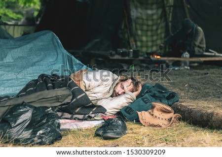 Ukraine. Carpathian mountains. Hippy waterfall. Glade of hippies - July 20, 2019. Hippy festival. A man is resting in a tent. Wild Life #1530309209