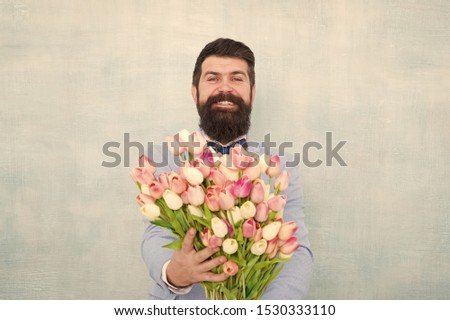 Gentleman romantic surprise for her. Flowers delivery. Gentleman romantic date. Birthday greetings. Best flowers for girlfriend. Spring holiday. Man bearded suit bow tie hold tulip flowers bouquet. #1530333110