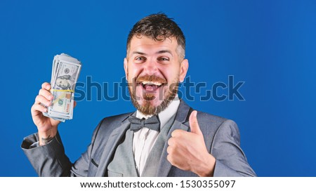Cash transaction business. Man happy winner rich hold pile of dollar banknotes blue background. Easy cash loans. Win lottery concept. Businessman got cash money. Get cash easy and quickly. #1530355097