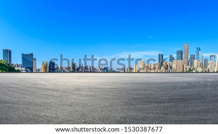 Wide race track ground and city financial district with buildings in Chongqing,China. #1530387677