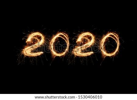 New Year 2020 light. Sparklers draw figures 2020. Bengal lights and letter #1530406010
