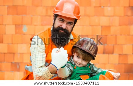 Successful construction business. Technician and builders and engineers. Mechanics and Construction Worker People teamwork. Father and son work together. #1530407111