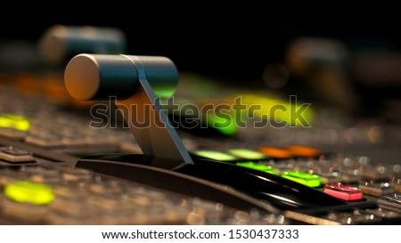 Blur image video switch of Television Broadcast, working with video and audio mixer, control broadcasts in recording studio. Broadcasting in the studio, professional mixing sender color buttons. Royalty-Free Stock Photo #1530437333