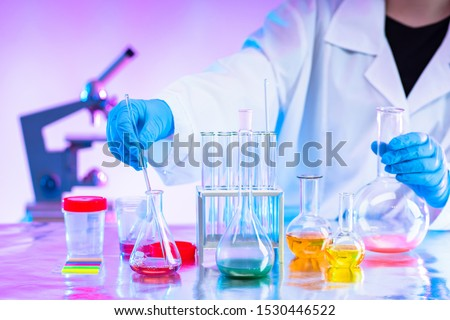 Chemistry. Mixing of chemical reagents. Chemist. A man works in a laboratory. Checking chemical reactions. Organic chemistry. Laboratory synthesis. A human mixes liquids. Career chemist. #1530446522