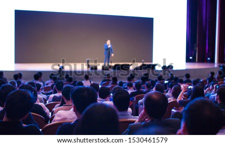 Seminar presenter at corporate conference giving speech. Speaker giving lecture to business audience. Entrepreneur forum executive manager leading discussion in hall during company training event.   #1530461579