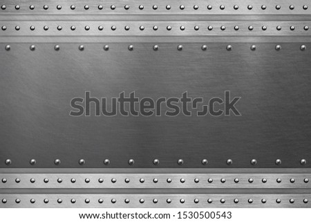 Metal frame background, steel plate with rivets and bolts