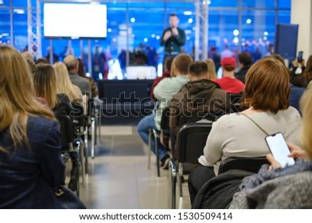 Audience listens lecturer at workshop conference hall #1530509414