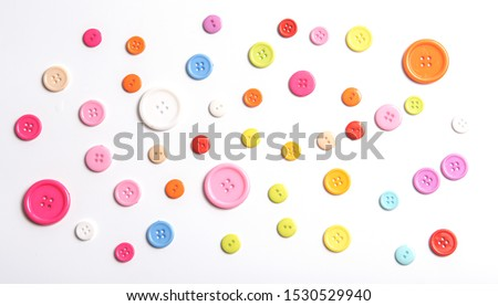 Top view Colorful Shirt Button Closeup isolated on White Background Royalty-Free Stock Photo #1530529940