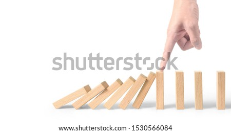 Hand stopping the Domino effect stopped by unique, Business Ideas #1530566084