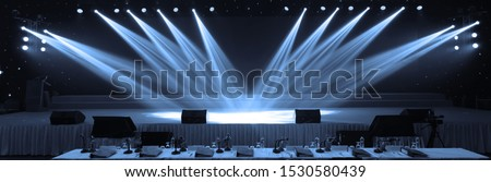 Empty stage and concert lighting background in award ceremony theme creative or singing contest Royalty-Free Stock Photo #1530580439