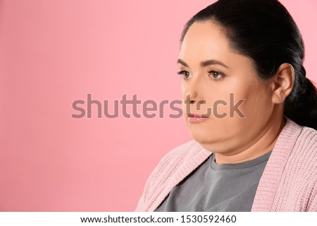 Woman with double chin on pink background. Space for text #1530592460