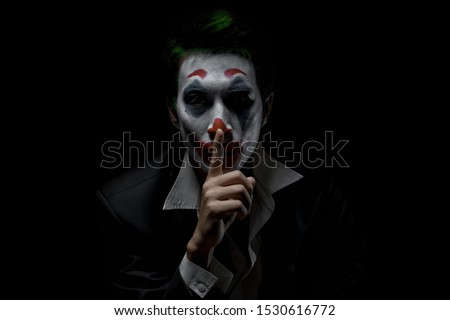 Makeup for Halloween: Image of a man in a joker makeup #1530616772