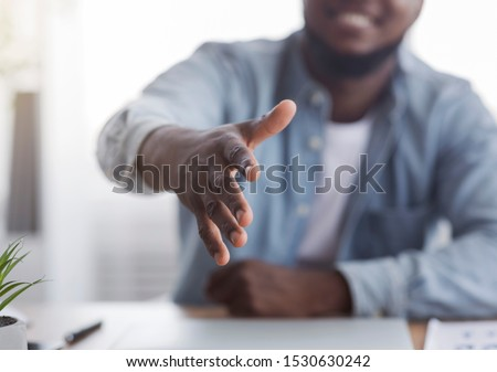 You're hired. Smiling black HR manager extending hand for handshake after successful job interview, selective focus on arm. Royalty-Free Stock Photo #1530630242