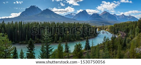 Iconic view of Morants Curve where the Canadian Pacific Railway runs along the stunning Bow River with the beautiful Canadian Rockies in the background, Banff National Park, Alberta, Canada Royalty-Free Stock Photo #1530750056