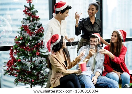 Ethnically diverse group of employees are celebrating Christmas party at the office. #1530818834