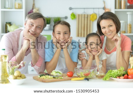 Close up portrait of cute family cooking #1530905453