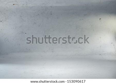 concrete studio room with spotlights