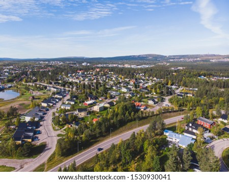 Aerial summer sunny view of Gallivare town, a locality and the seat of Gallivare Municipality in Norrbotten County, province of Lapland, Sweden #1530930041
