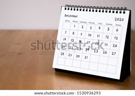 Month page: December in 2020 paper calendar with funny font on the wooden table Royalty-Free Stock Photo #1530936293