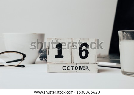 October 16th . October 16 white wooden calendar on white background. Autumn day. Copy space for your text. #1530966620