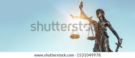Lady justice. Statue of Justice on sky background. Legal and law concept Royalty-Free Stock Photo #1531049978
