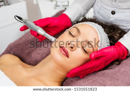 Beautiful woman receiving microneedling rejuvenation treatment. Mesotherapy.  Royalty-Free Stock Photo #1531051823