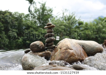 STONE BALANCING stone balancing is an art, discipline, or hobby in which rocks are naturally balanced on top of one another in various positions without the use of adhesives, wires, supports, #1531127939