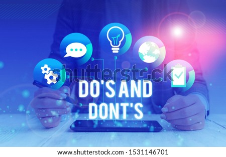 Conceptual hand writing showing Do S And Dont S. Business photo showcasing Rules or customs concerning some activity or actions Female human wear formal work suit presenting smart device. #1531146701
