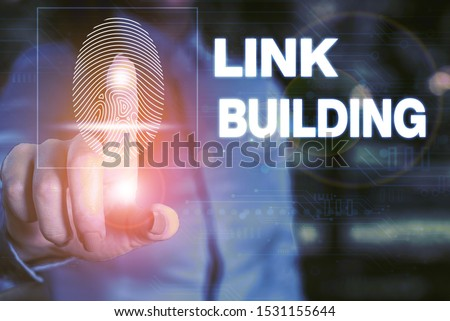 Handwriting text writing Link Building. Concept meaning SEO Term Exchange Links Acquire Hyperlinks Indexed Woman wear formal work suit presenting presentation using smart device. #1531155644