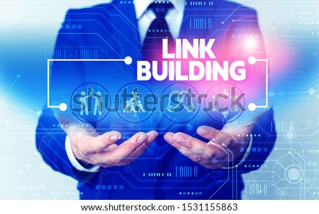 Word writing text Link Building. Business concept for SEO Term Exchange Links Acquire Hyperlinks Indexed Male human wear formal work suit presenting presentation using smart device. #1531155863