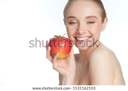 Cute young lady holding red apple while isolated on white background #1531162103