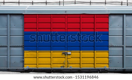 Front view of a container train freight car with a large metal lock with the national flag of Armenia.The concept of export-import,transportation, national delivery of goods and rail transportation #1531196846