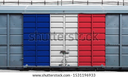 Front view of a container train freight car with a large metal lock with the national flag of France.The concept of export-import,transportation, national delivery of goods and rail transportation #1531196933