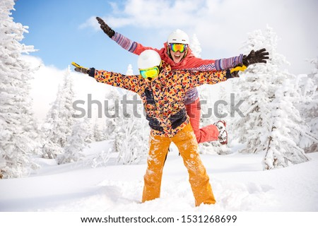 Happy couple skier and snowboarder are having fun at ski resort. Ski winter sports concept #1531268699