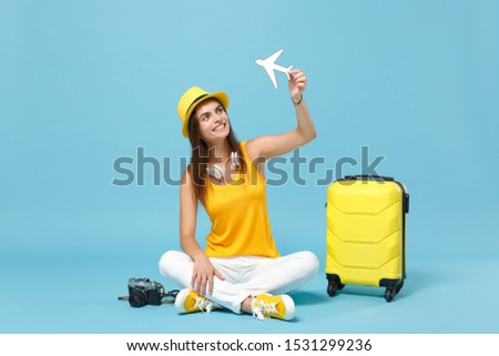 Traveler tourist woman in yellow casual clothes hat with suitcase photo camera isolated on blue background. Female passenger traveling abroad to travel on weekends getaway. Air flight journey concept #1531299236