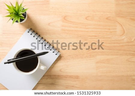 Flat lay, top view office table white desk. Workspace with notepad, pen, green leaf, and coffee cup on white background. #1531325933