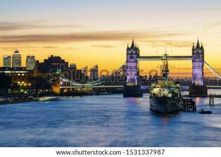 London, England - January 22 2018: Tower bridge in London and Hms Belfast seen before sunrise. #1531337987