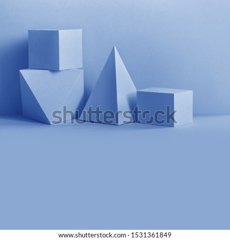 Abstract geometrical composition. Prism pyramid rectangular cube objects on blue background. Platonic solids figures, simplicity concept. copy space #1531361849