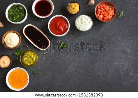 Sauces Assortment. Set of various sauces. Popular sauces in bowls, top view, copy space. Homemade sauces or dip. #1531382393